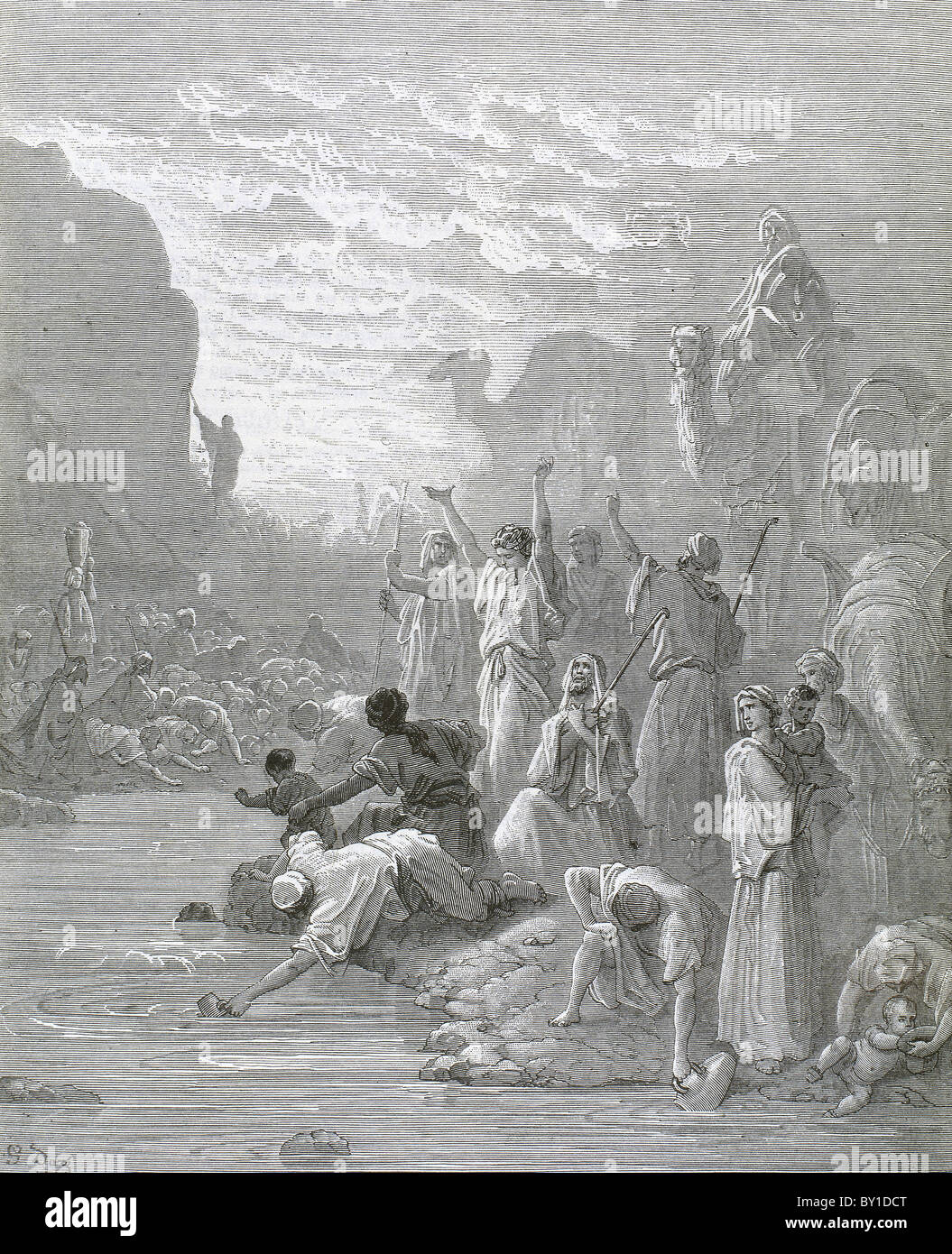Moses brings forth water from the rock. Book of Exodus. G. Dore engraving. - Stock Image