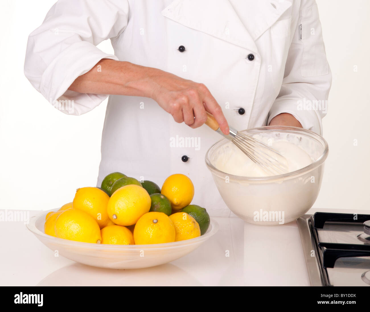 CHEF WHISKING EGG WHITES - Stock Image