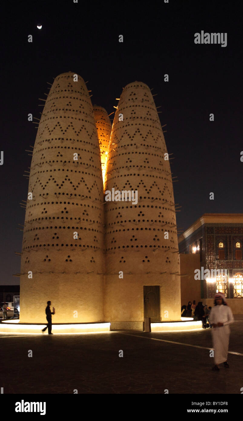 A traditional pigeon house in the Cultural Village (Katara), Doha, Qatar, at night with the moon above. - Stock Image