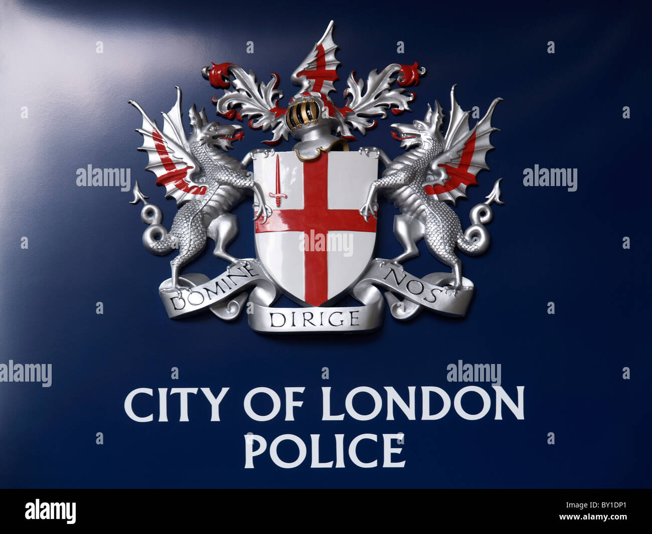 City of London Police emblem on dark blue background shot at Barbican towers domine dirige nos god guides us - Stock Image