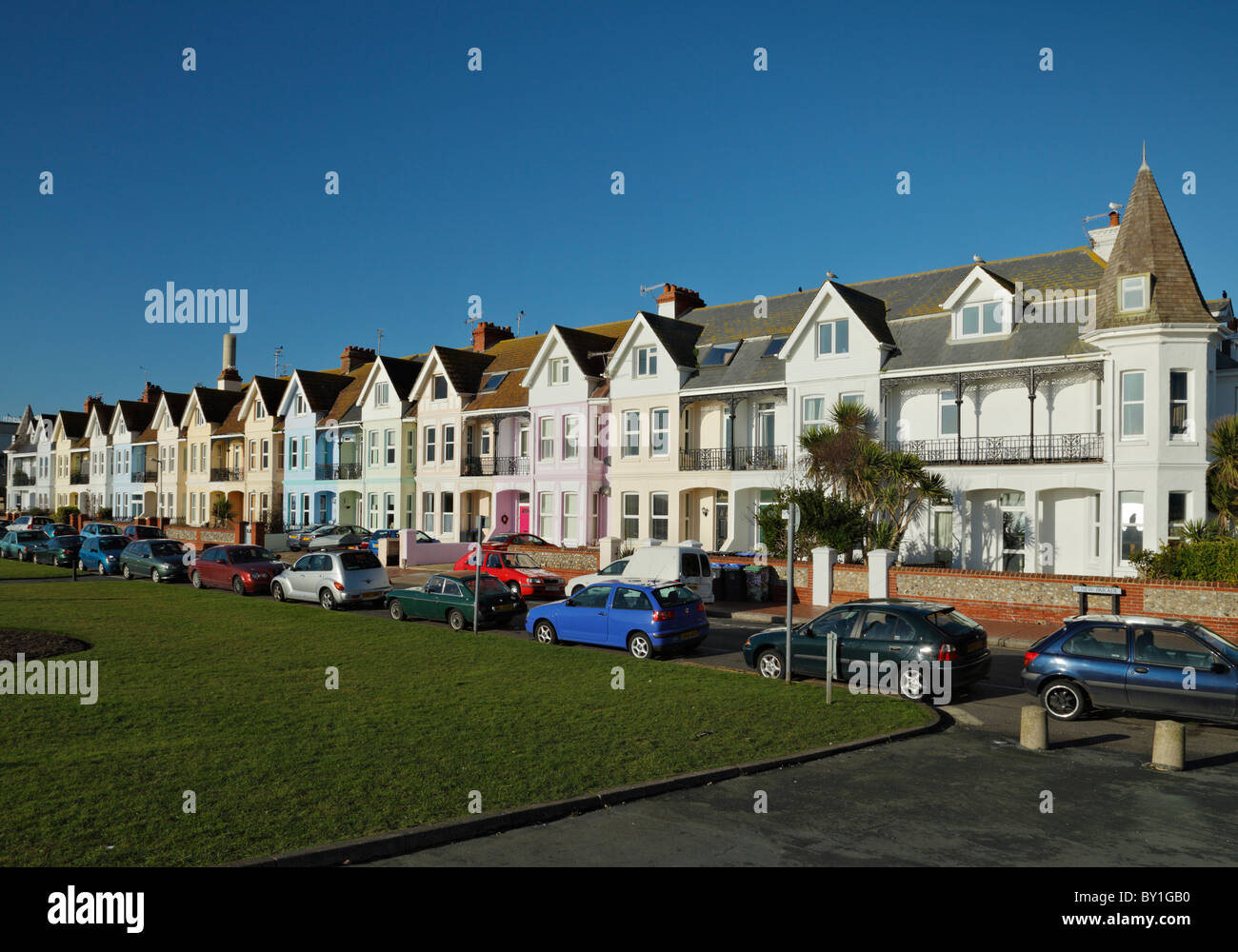 Row of colourful seafront residential housing, Worthing. - Stock Image