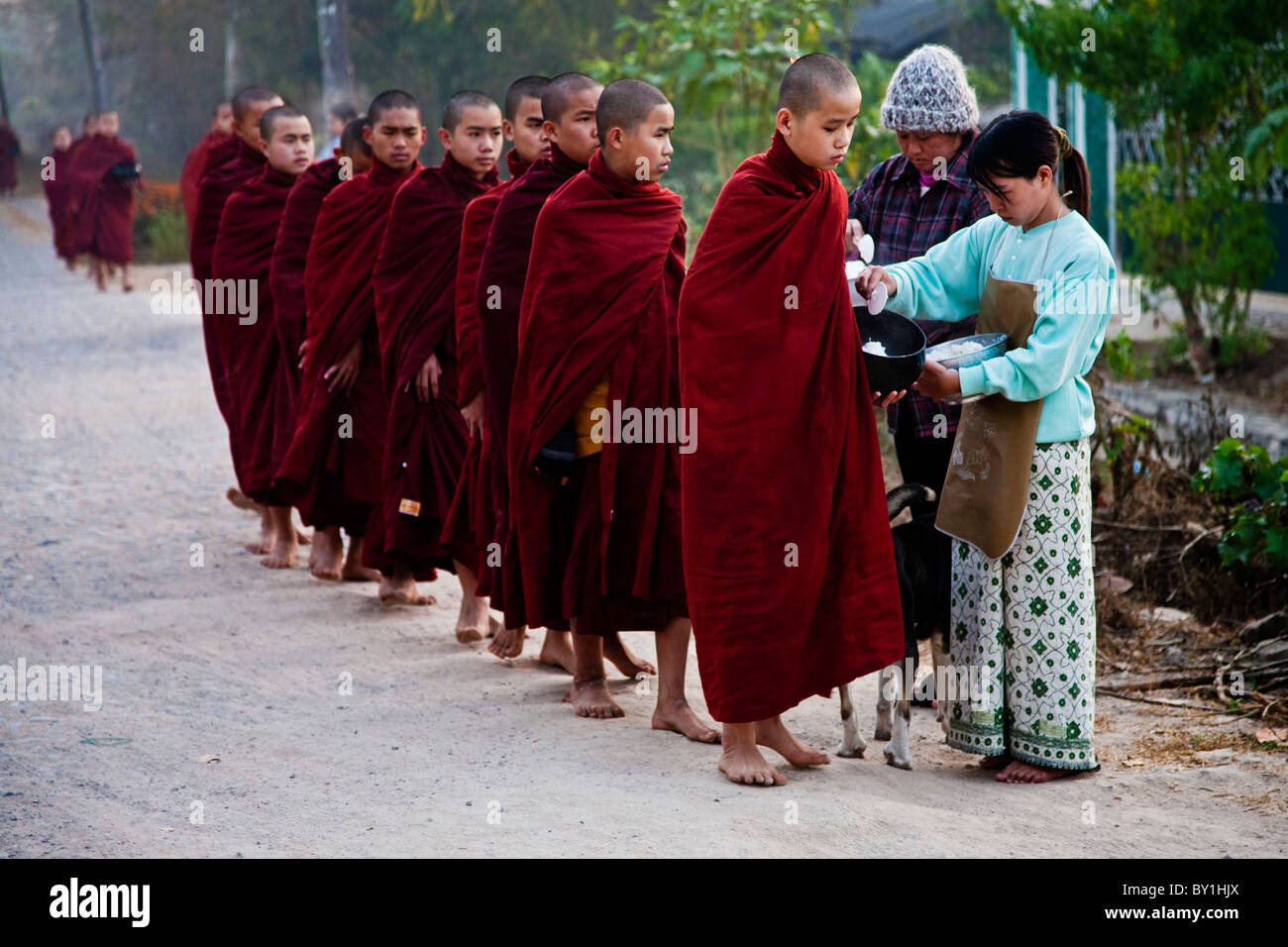 Myanmar, Burma, Loikaw. Monks lining up to collect alms, Loikaw Stock Photo