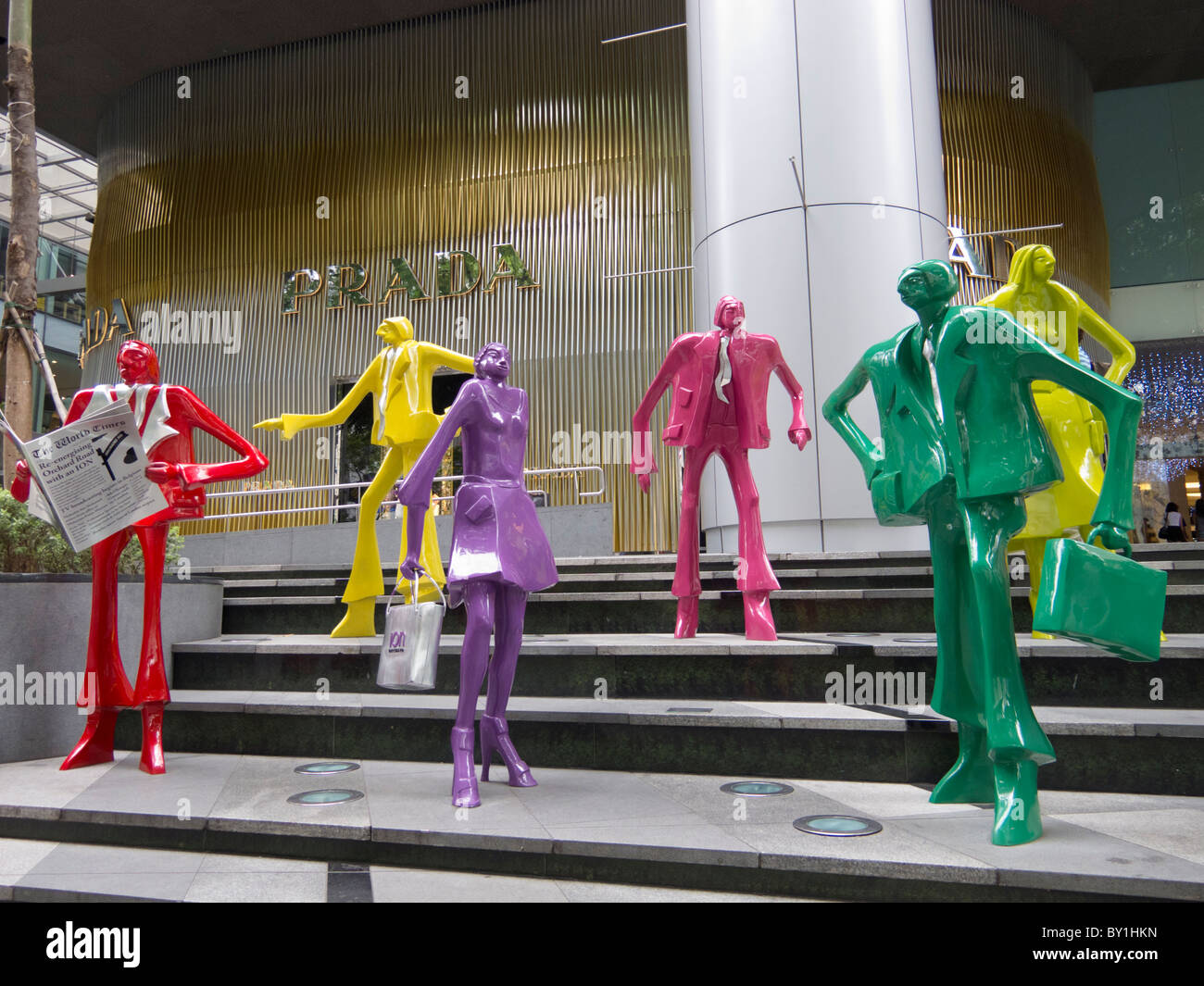 Colourful modern art sculptures outside shopping mall in Orchard Road in Singapore - Stock Image
