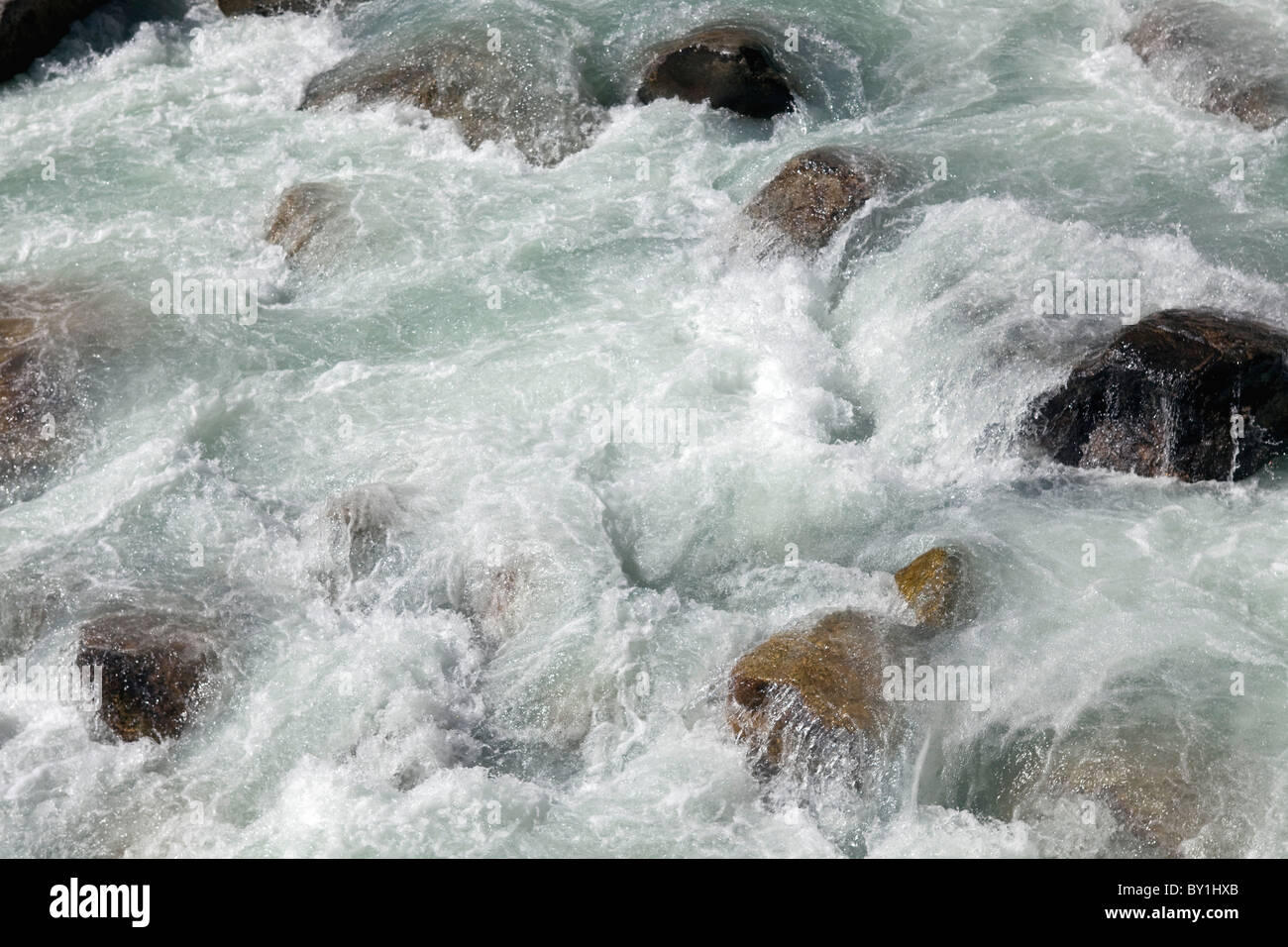 Nepal, Everest Region, Khumbu Valley.   Fast flowing glacially cold waters flowing down the Everest valley - Stock Image