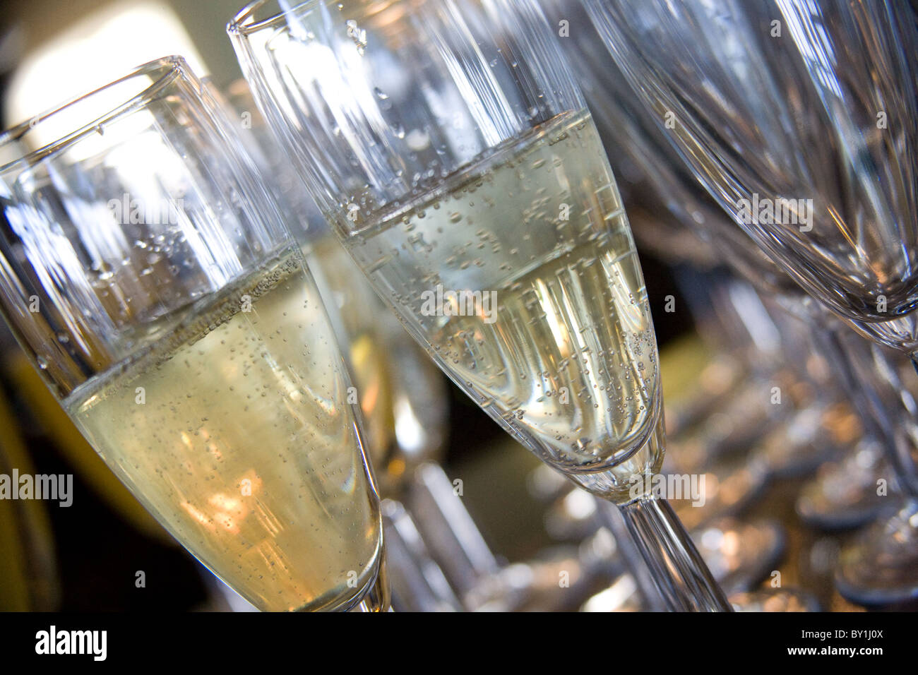 champagne in flute glasses - Stock Image