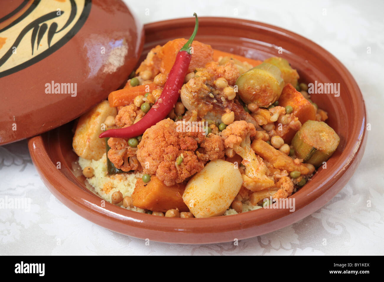 Moroccan chicken tagine stock photos moroccan chicken tagine stock moroccan food chicken tagine vegetables and chicken cooked in a tagine stock image forumfinder Images