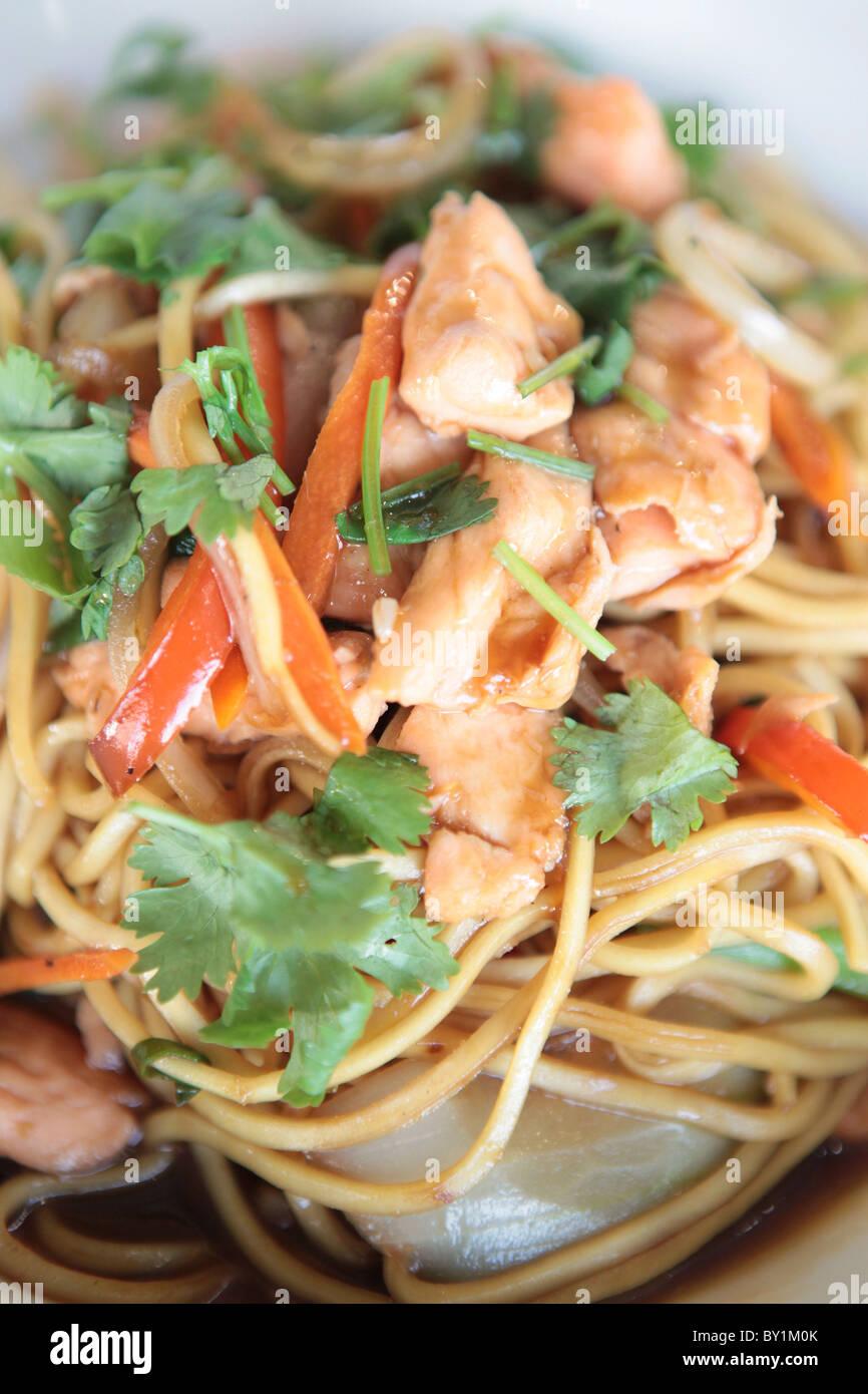 Stir fried Chicken noodles - Stock Image
