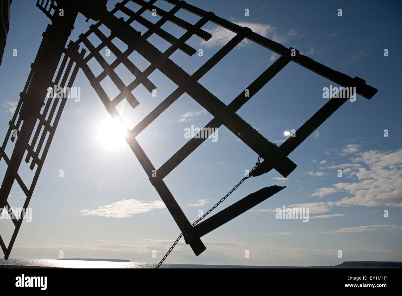 Sweden, Island of Gotland.  The vanes of a windmill looking out over the water of the Baltic - Stock Image