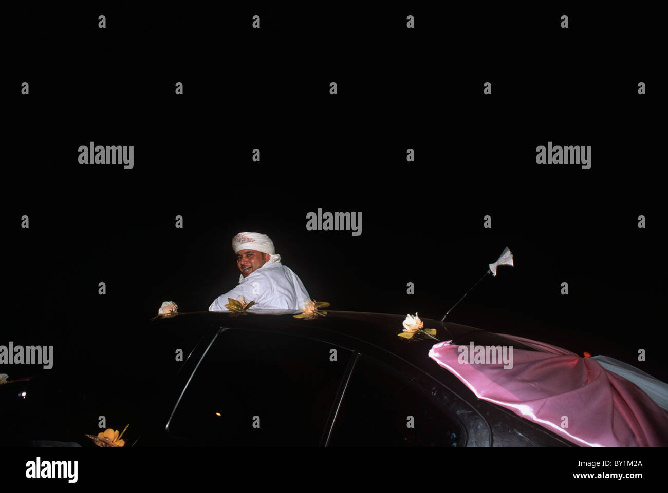 Bedouin groom on celebratory ride after picking up bride at her home. El Tur, Sinai Peninsula, Egypt - Stock Image