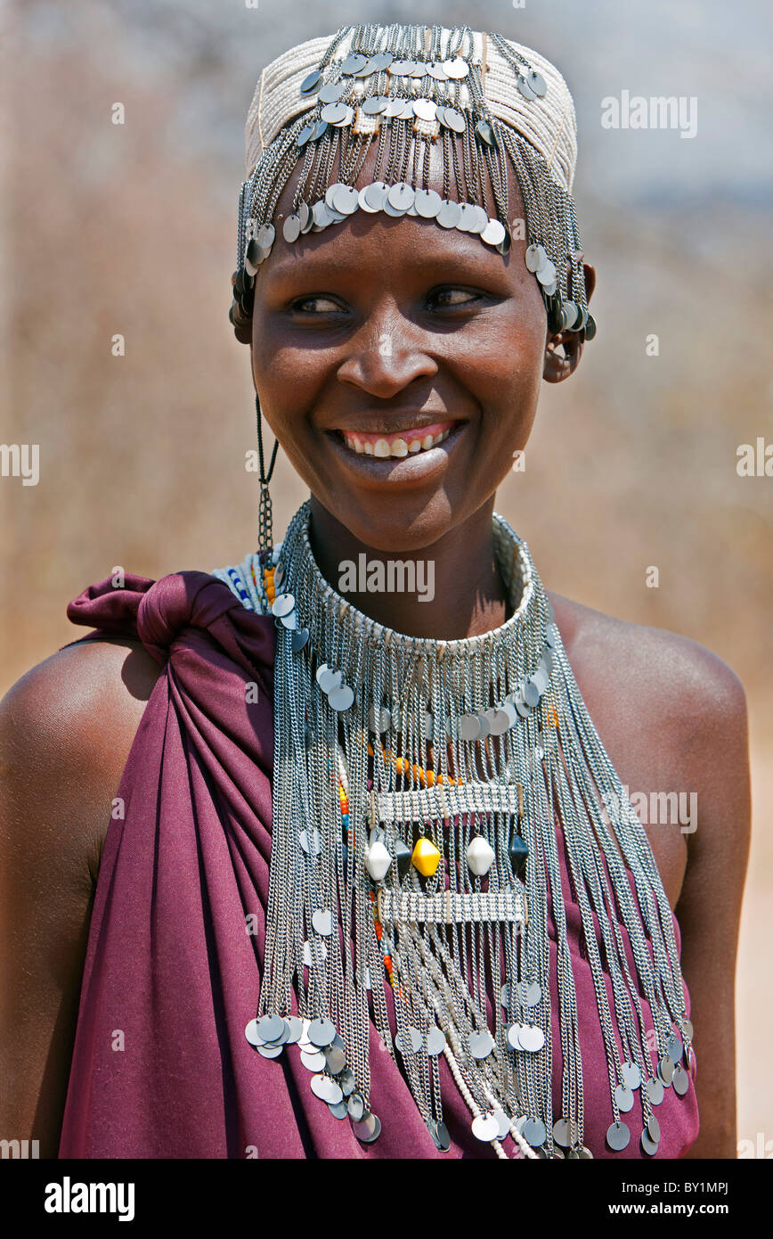 A Maasai girl from the Kisongo clan wearing an attractive beaded headband and necklace. - Stock Image