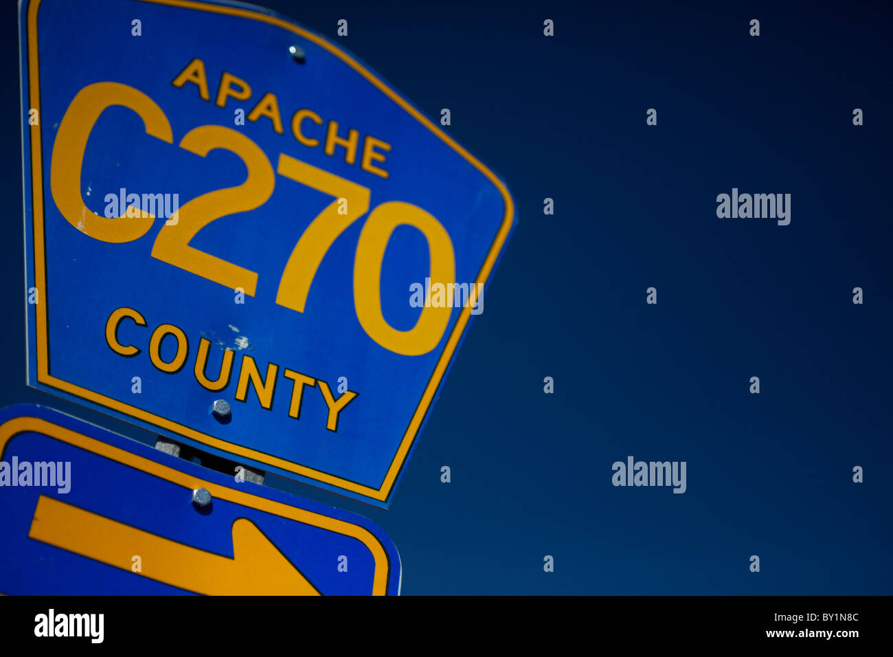USA, Arizona, Apache Country. A road signpost of a desert road for Apache Country - an mainly arid desert area set - Stock Image
