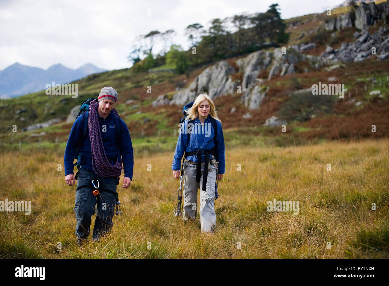 UK, North Wales, Snowdonia.  Man and woman in climbing harness.  (MR) - Stock Image