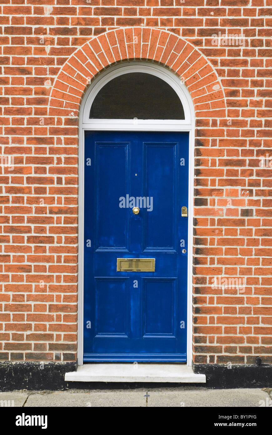 Front door set in new brickwork - Stock Image
