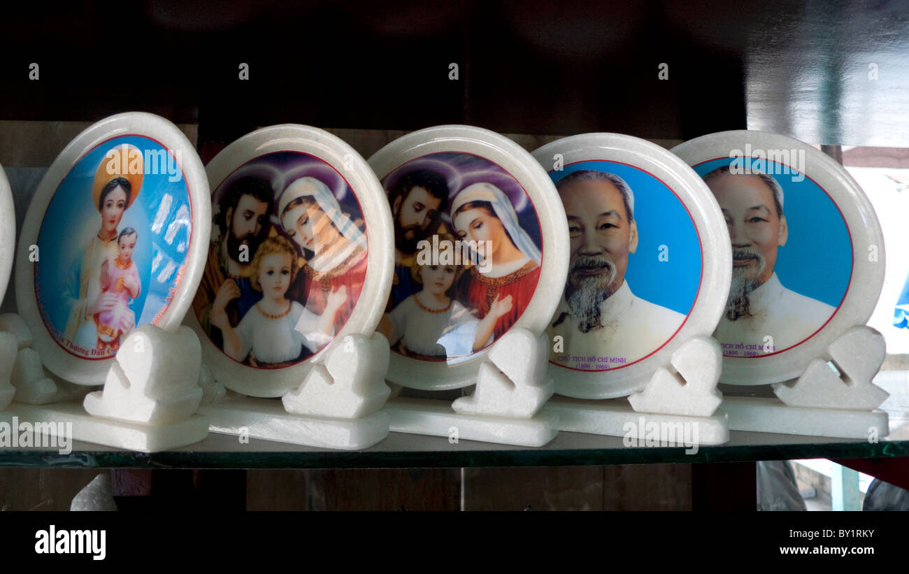 Religious and political iconography for sale at a shop at Marble Mountain religious caves, Danang, Vietnam - Stock Image