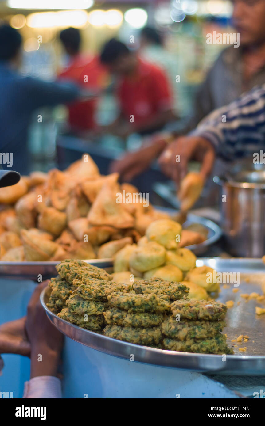 Food on sale at a market in Bhopal, India - Stock Image
