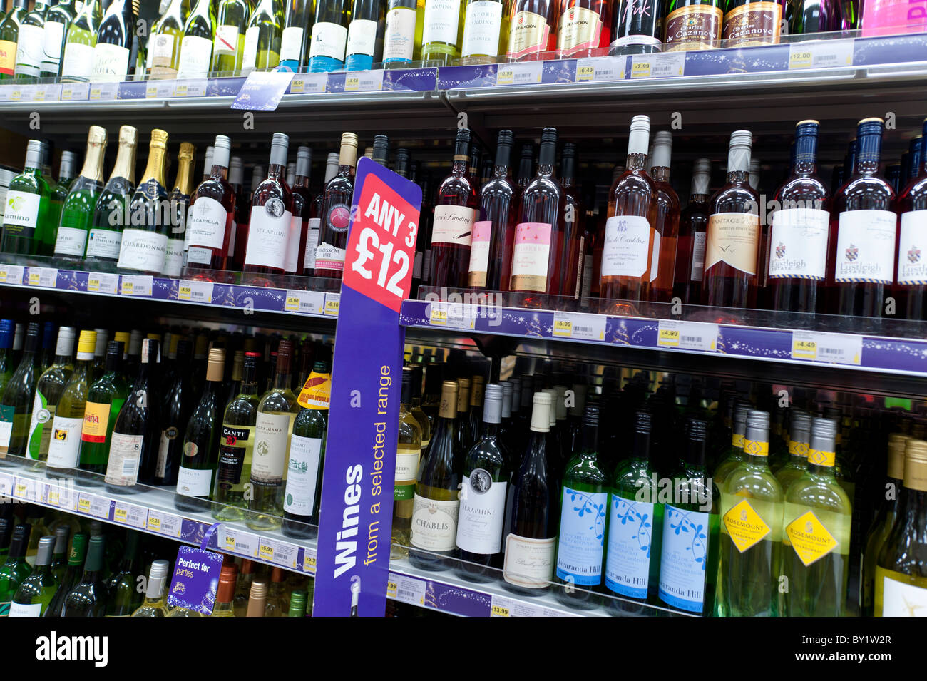 Bottles of wine on sale in a Co-op supermarket, UK - Stock Image