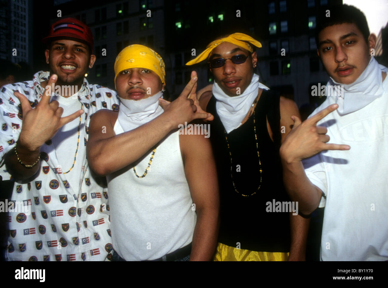 Members of the Latin Kings gang display their gang signs during a rally for racial justice in New York in 1998 - Stock Image