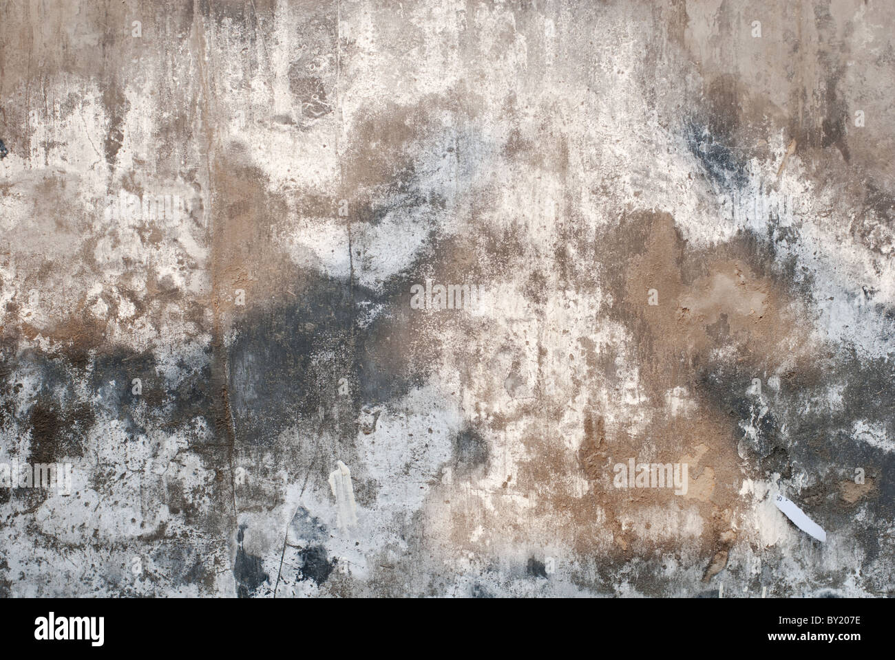 Detail Of A Concrete Wall With Cracks And White Mold Stock Photo