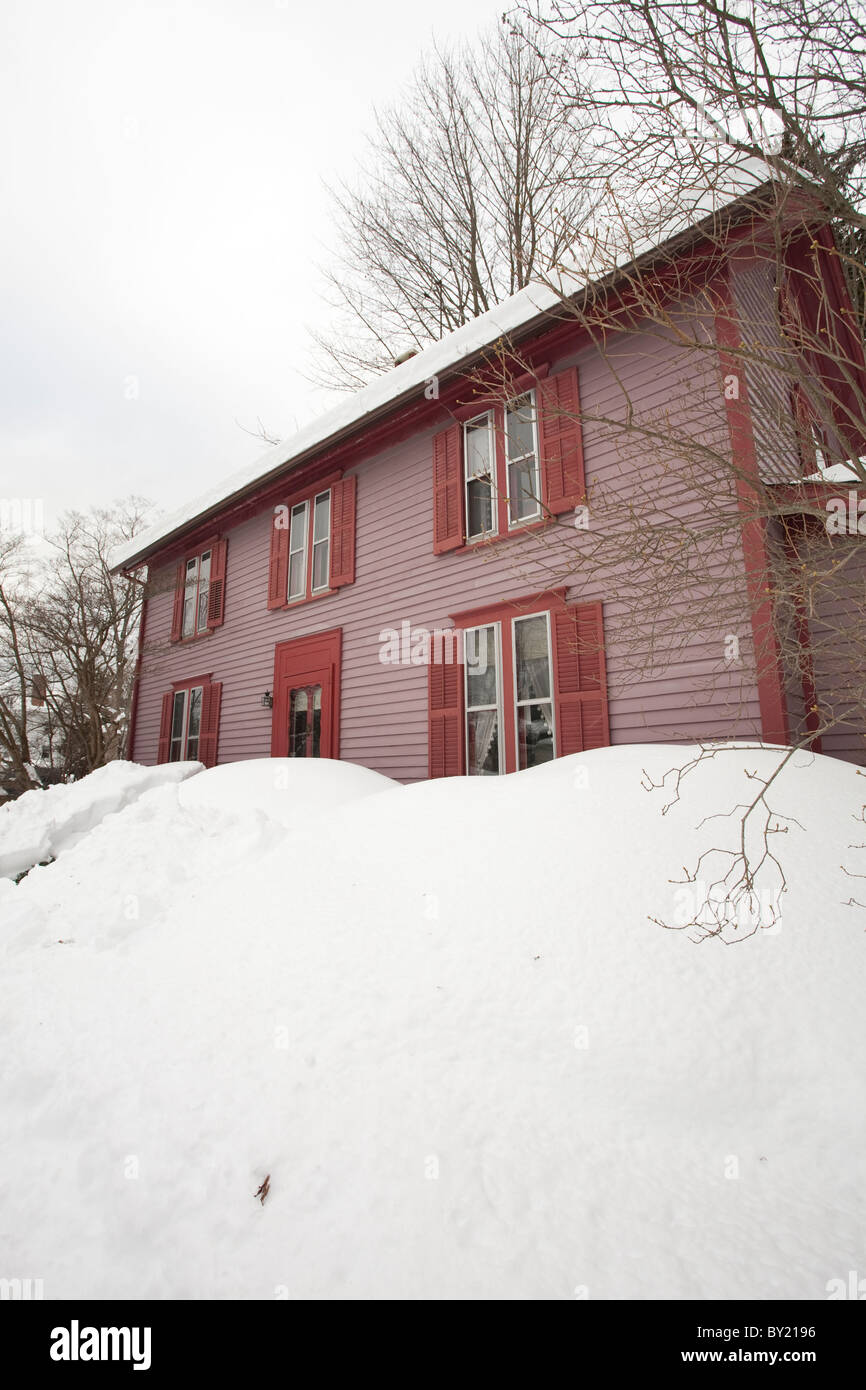 Snow is up to the window sills of a colonial home in Stockbridge Stock Photo