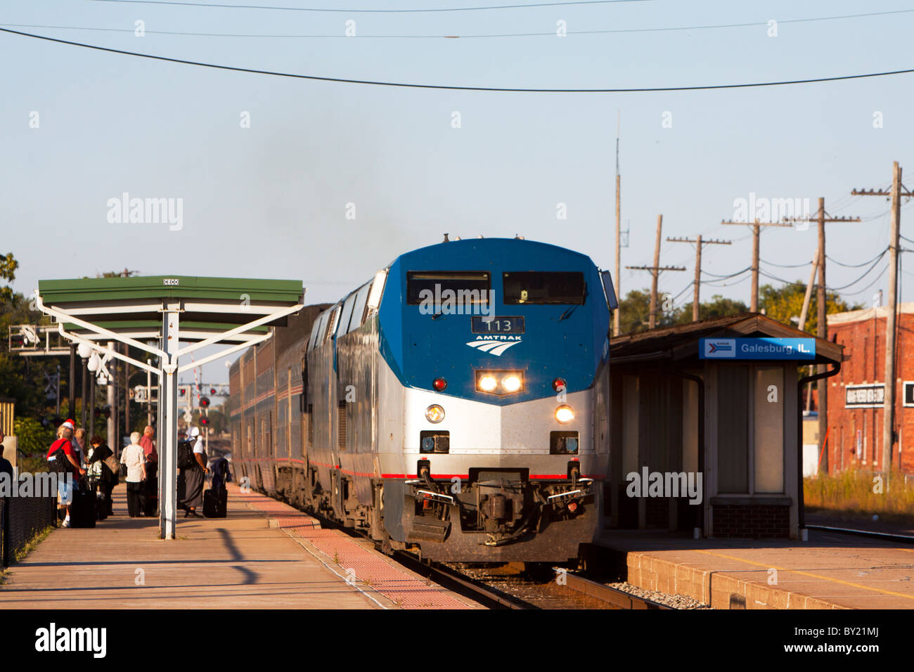 A long distance Amtrak train slows to a stop at the Galesburg, IL depot. - Stock Image
