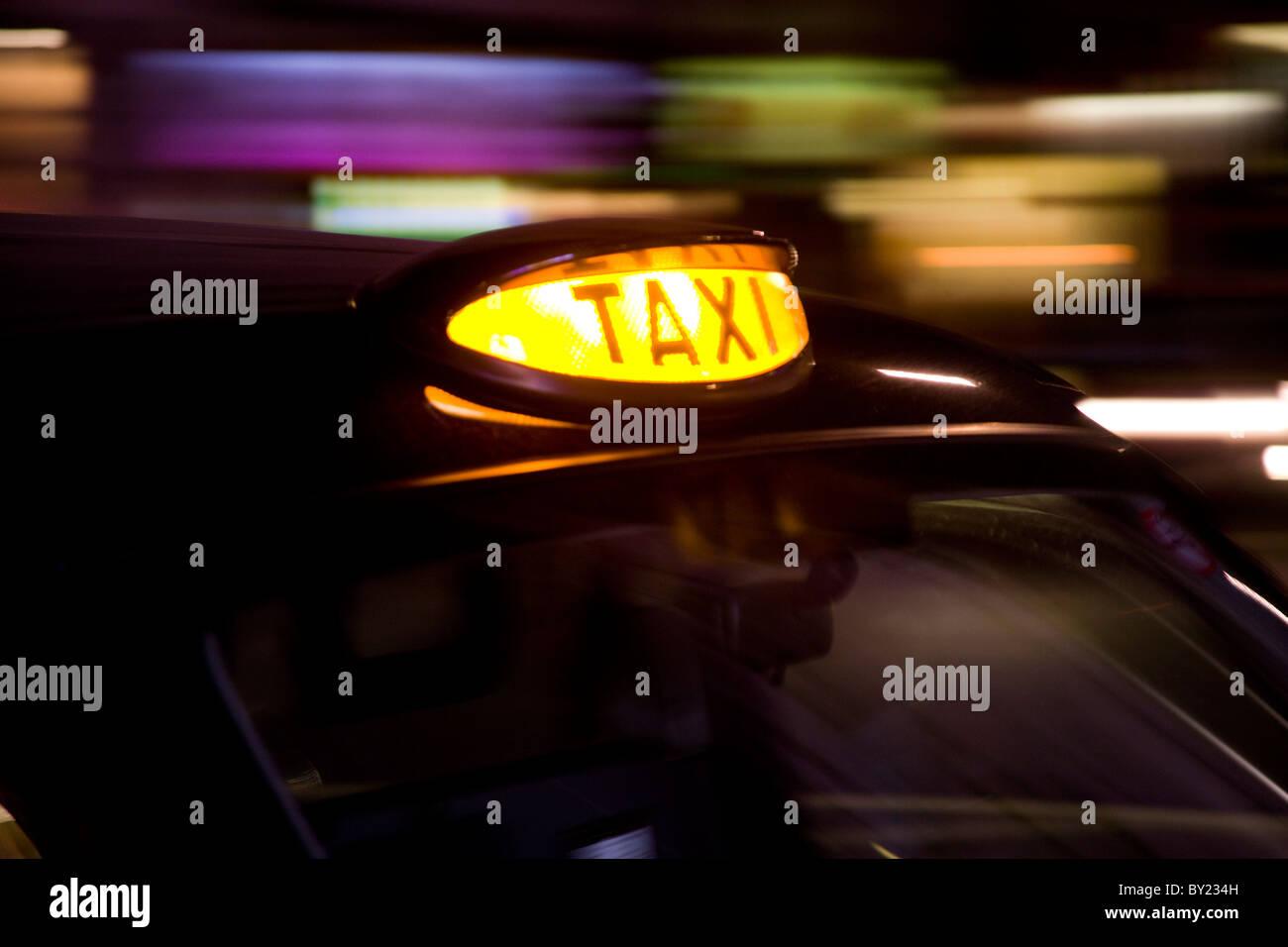 Taxicab at night, London, UK - Stock Image