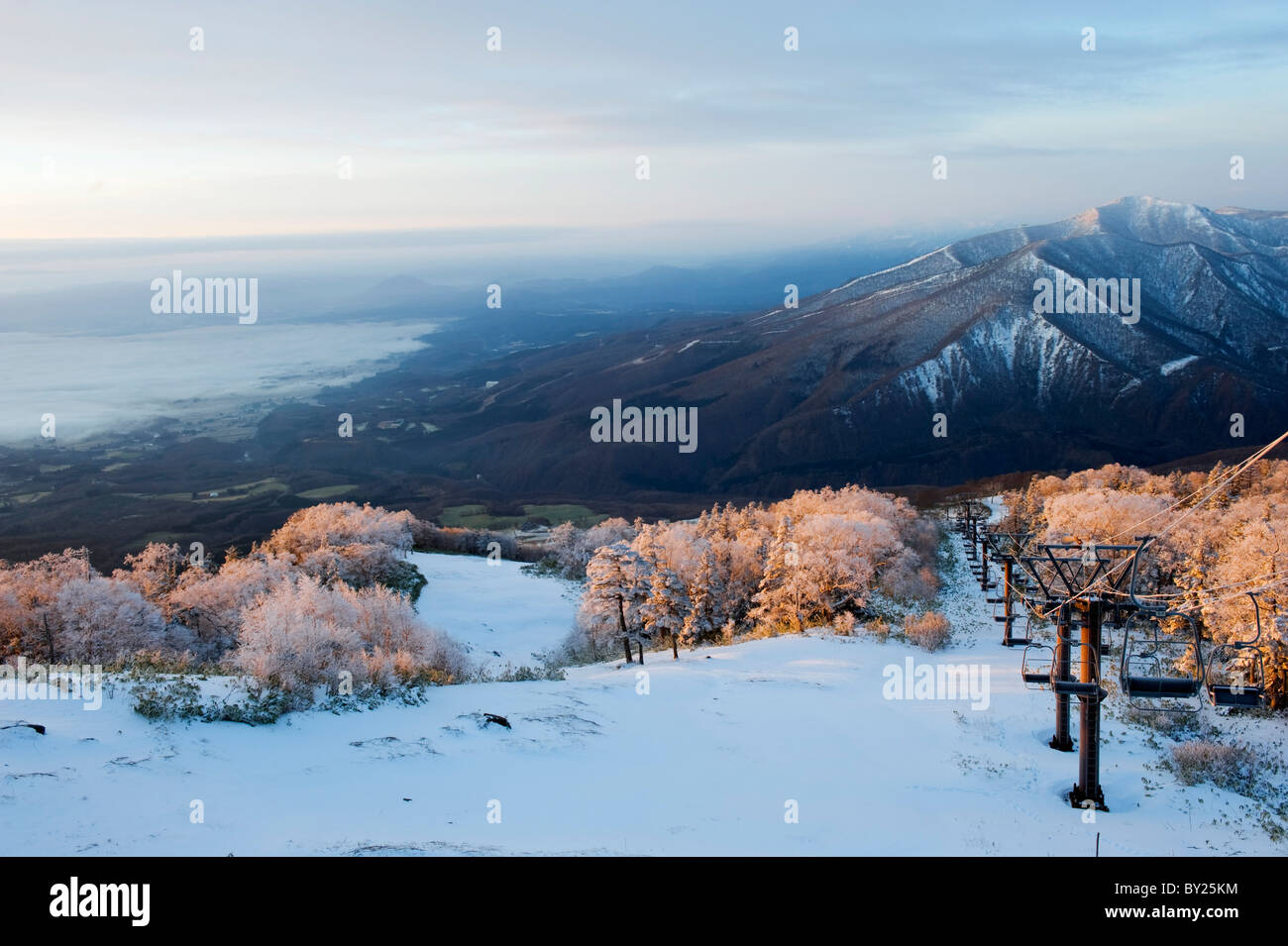 asia, japan. iwate prefecture, sunrise over snow covered towada