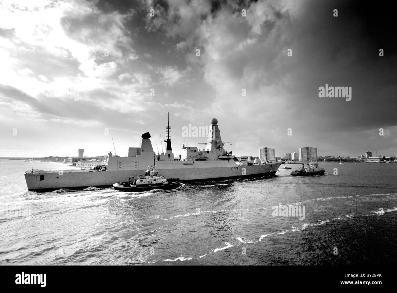 H.M.S Dauntless entering Portsmouth harbour - Stock Image