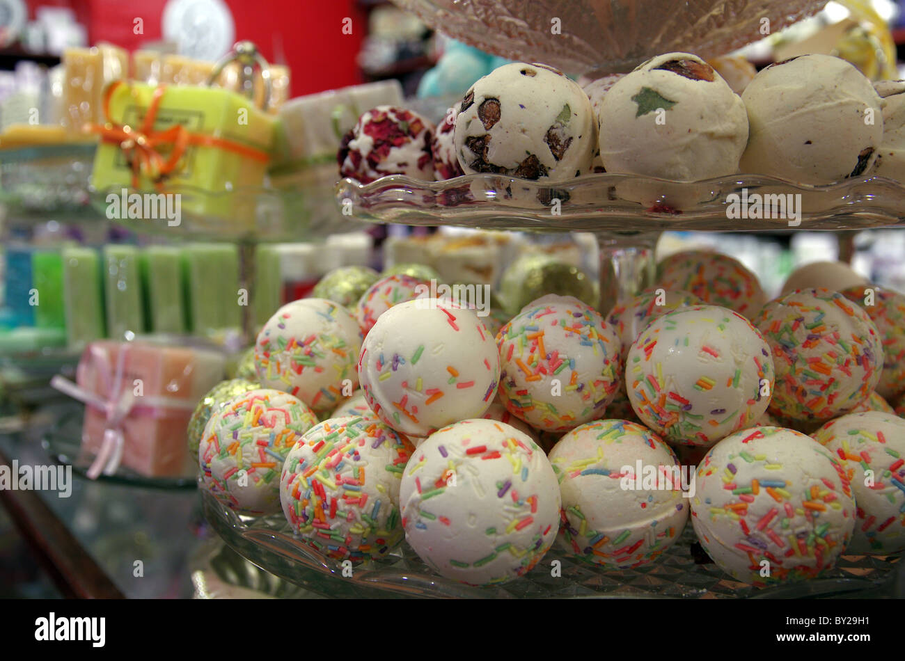 Bath bombs on display in a shop - Stock Image