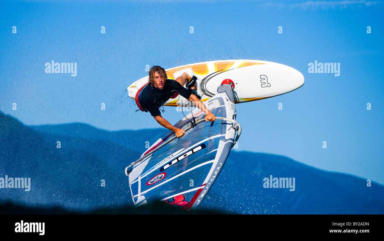 Windsurfer throws a shove it at the Spring Creek Fish Hatchery, WA. - Stock Image