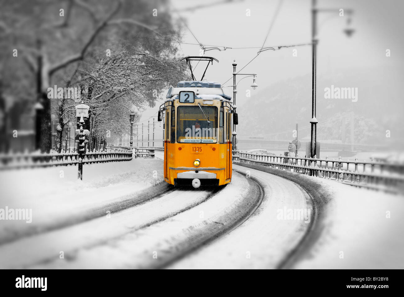 Traditional Yellow Budapest tram in the snow - Stock Image