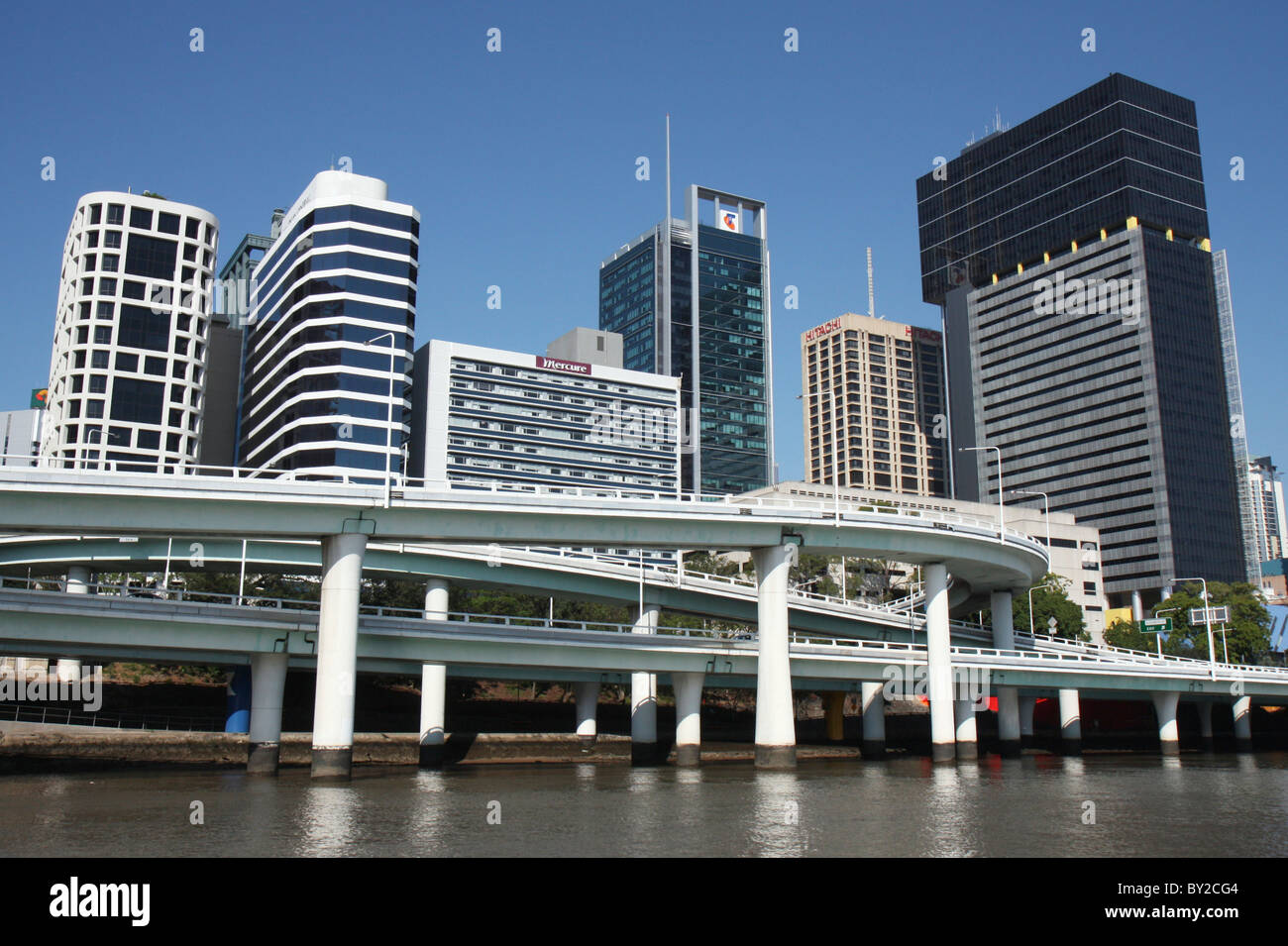 Brisbane CBD (City Centre) and elevated road taken from the river in Queensland, Australia - Stock Image