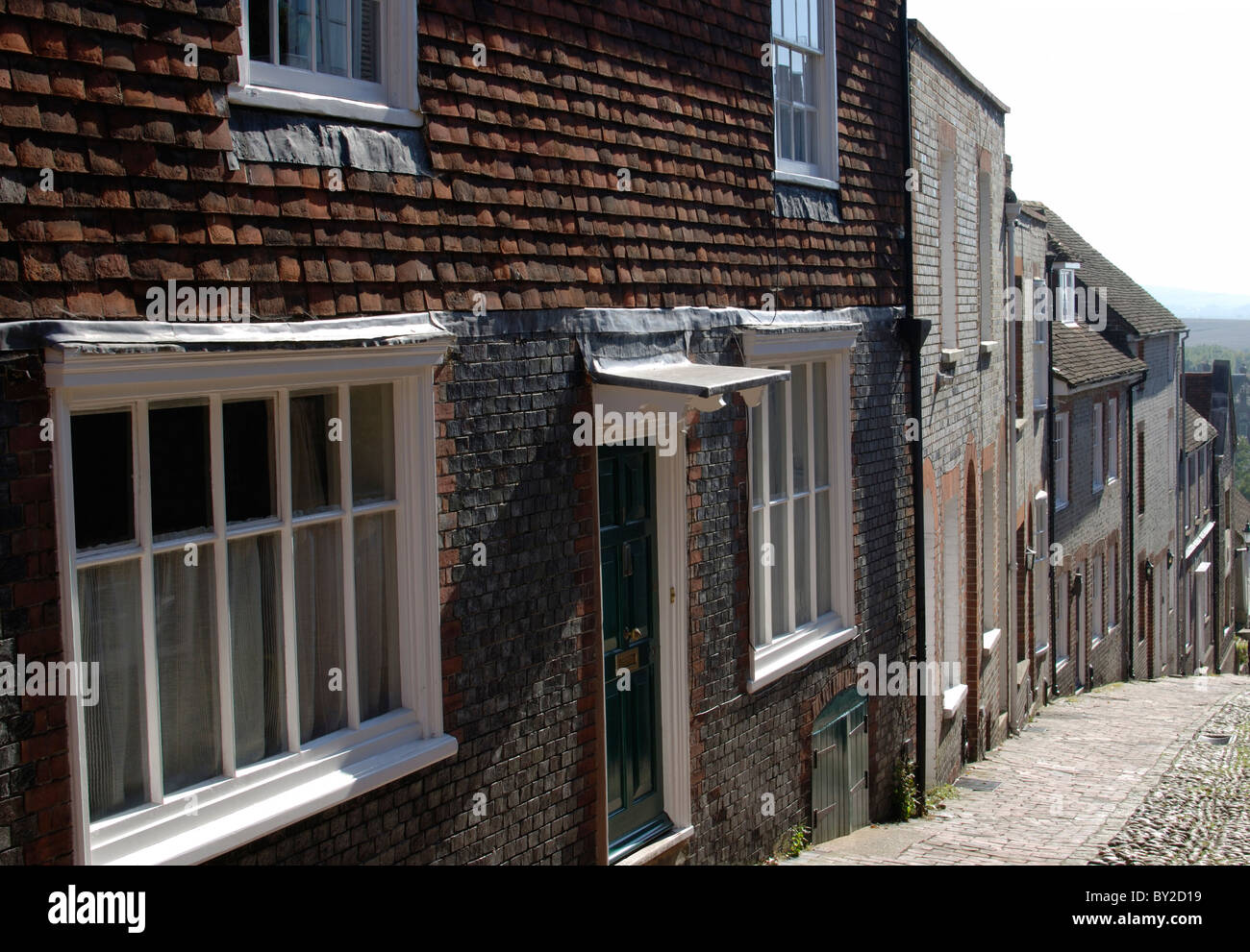 Steep, cobblestone street known as Keere Street. Lewes. East Sussex. England Stock Photo
