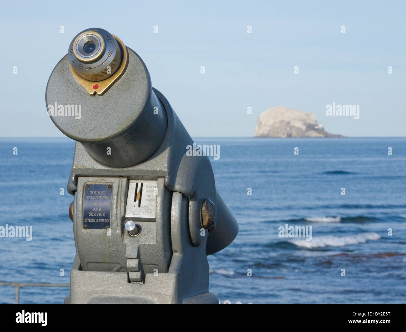 A coin operated telescope looking out to the Bass Rock from the town of North Berwick in Scotland. - Stock Image
