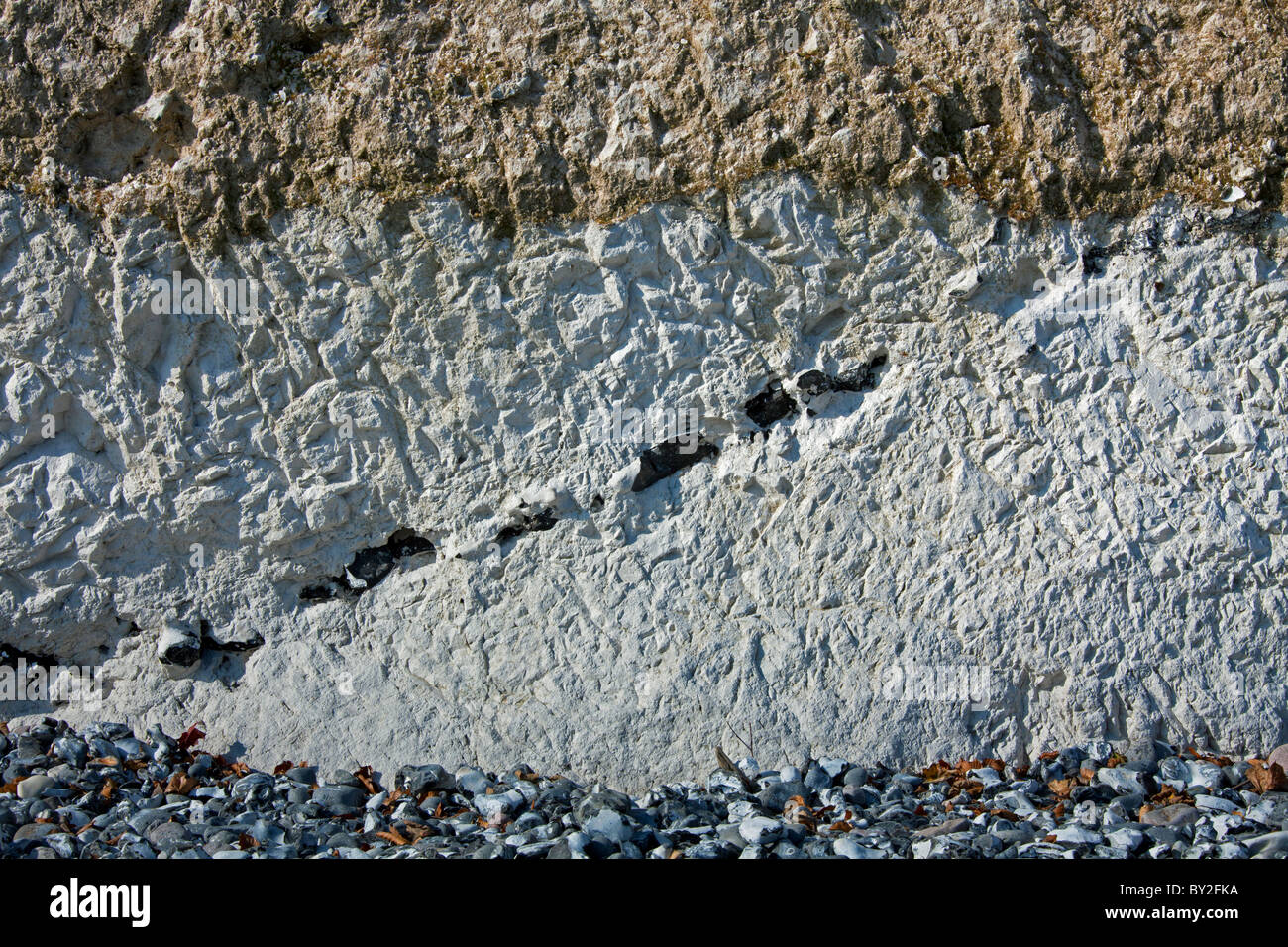 Chalk cliff showing layers of flint rock in Jasmund National Park on Rugen Island on the Baltic Sea, Germany - Stock Image