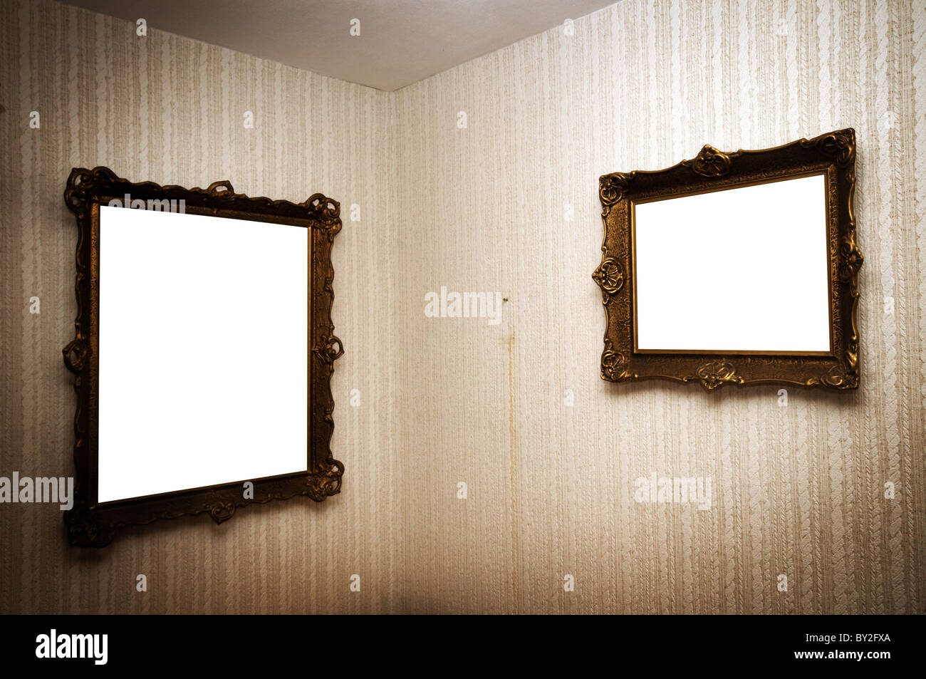 Old ornamented frames on retro grunge wall - Stock Image