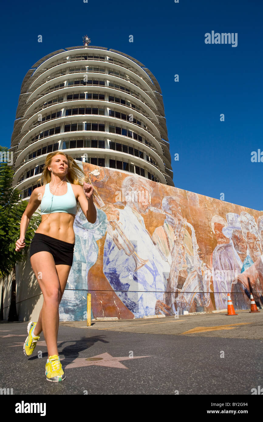 Woman running in Hollywood - Stock Image