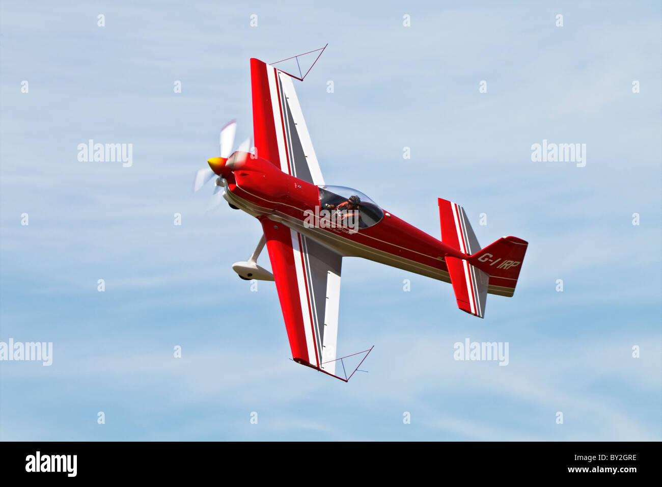 Mudry/Apex CAP232 aerobatic aircraft doing a knife edge - Stock Image