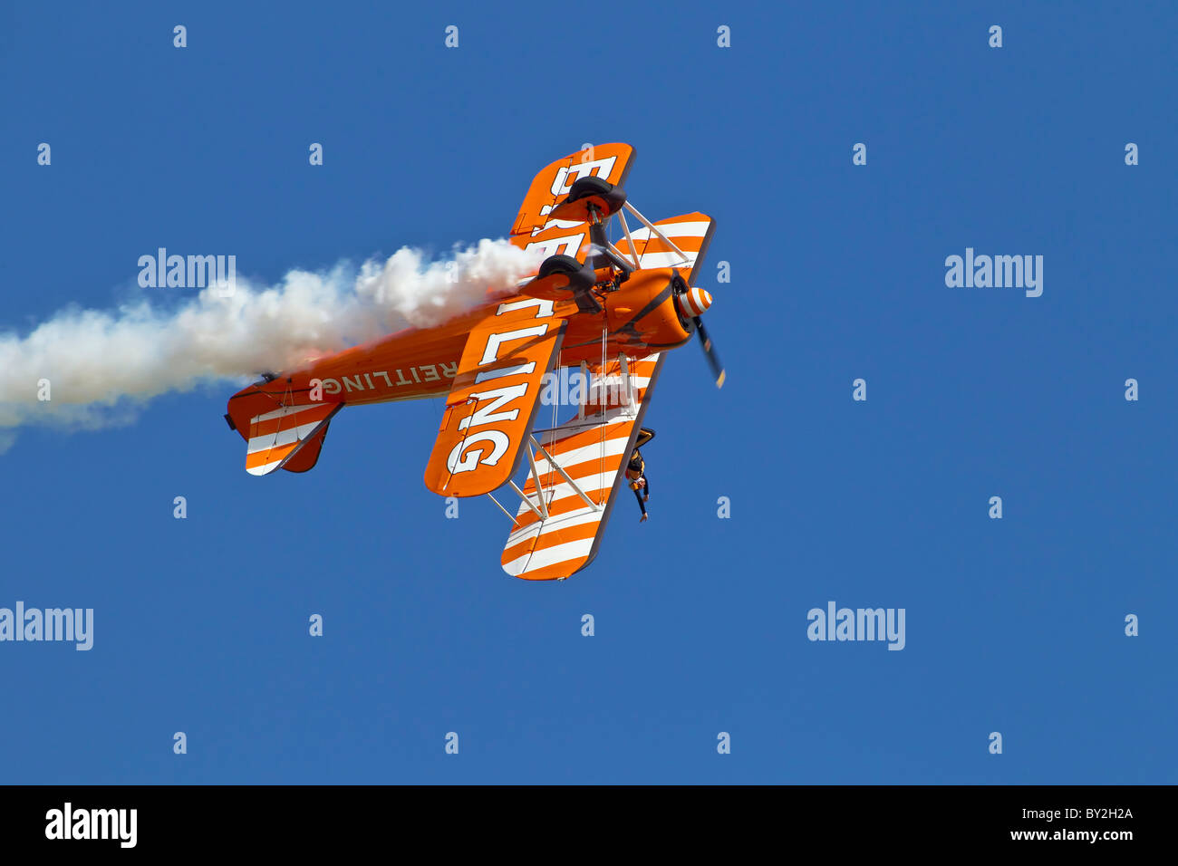 A Boeing PT17 Stearman's of the breitling wing walking aerobatic team rolling inverted - Stock Image