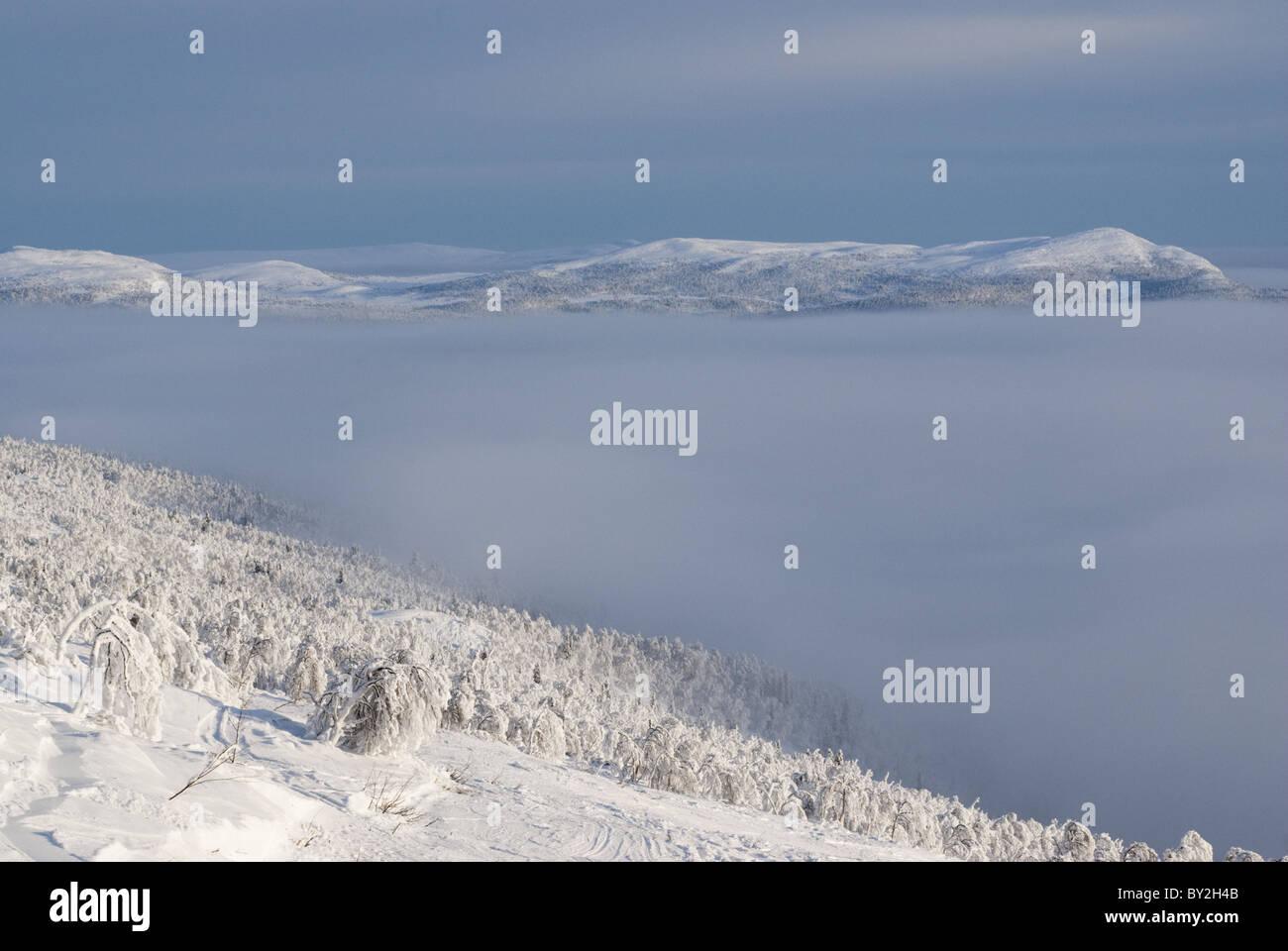 Cloud filled valey in Kittelfjäll, Swedish Lapland. - Stock Image