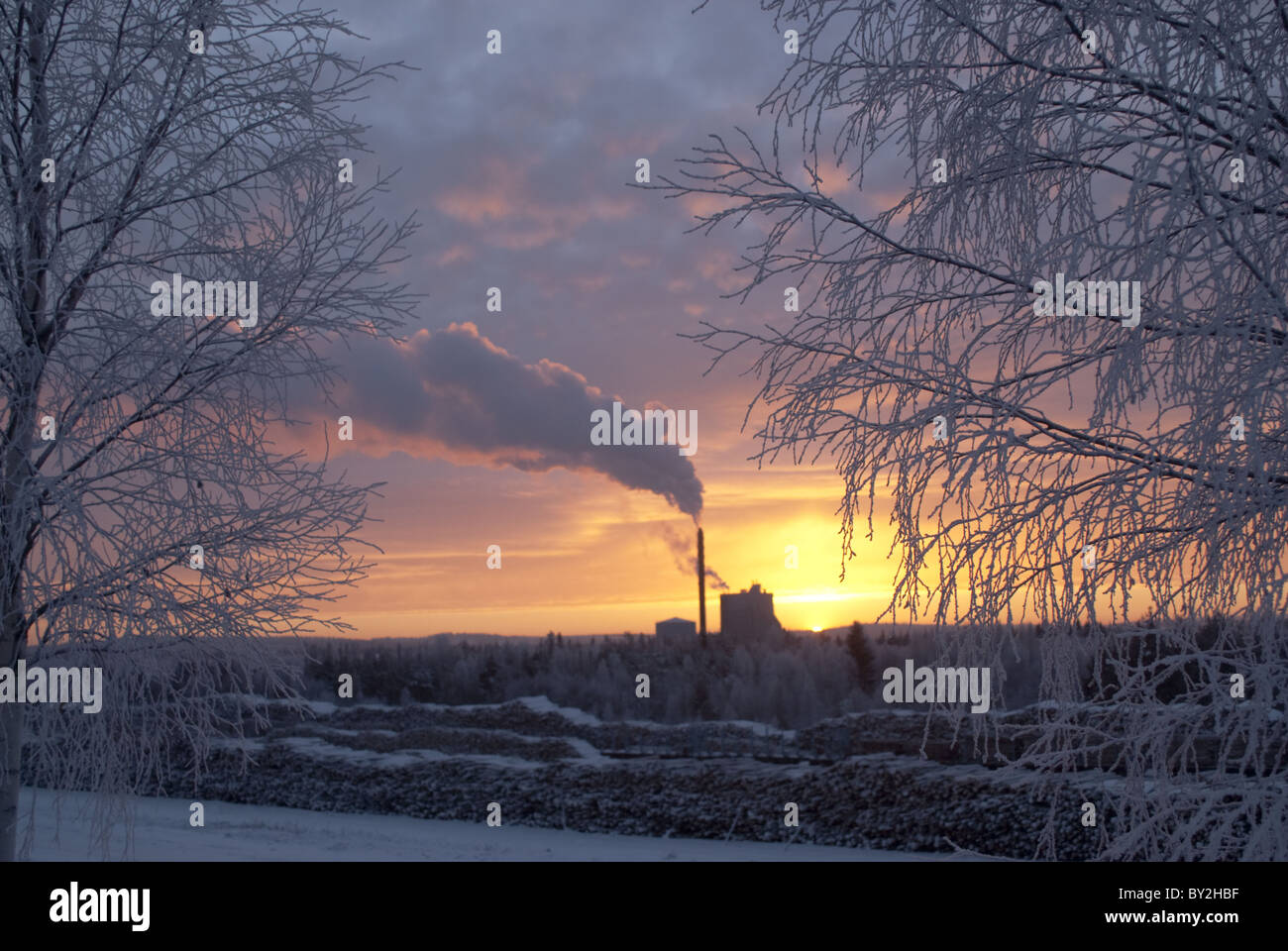 Sun barely rising above the horizon during the cold, short arctic winter day at  Rovaniemi, Finland on 24. of December. - Stock Image