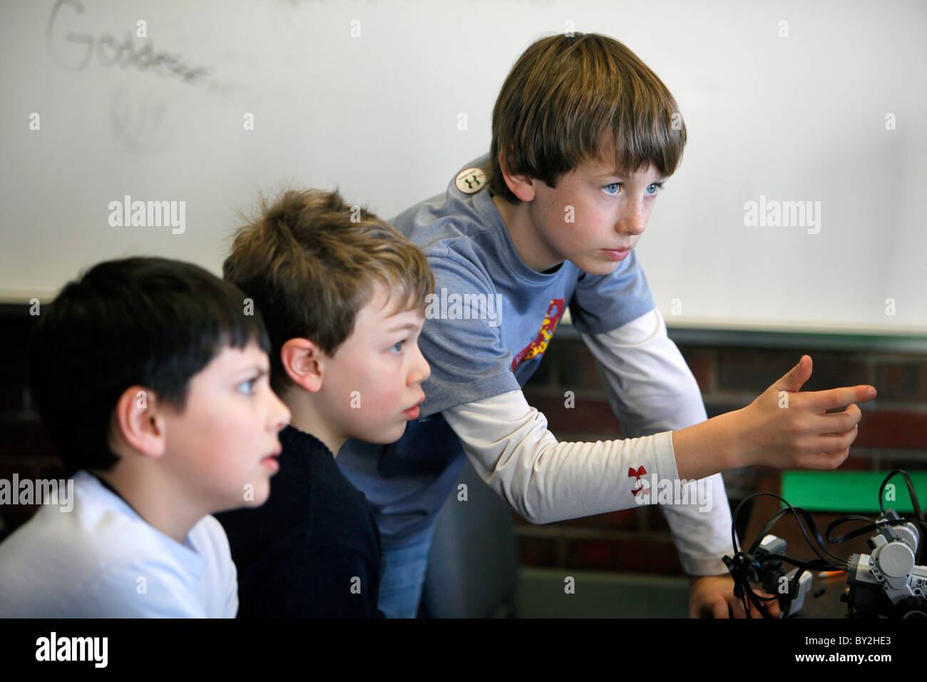 Preteen boys in a classroom setting - Stock Image