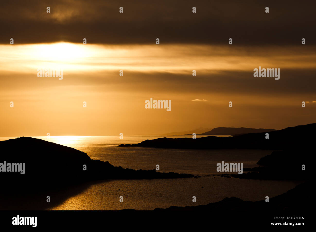 Sun setting over the Bays area of south Harris, Western Isles, Scotland - Stock Image