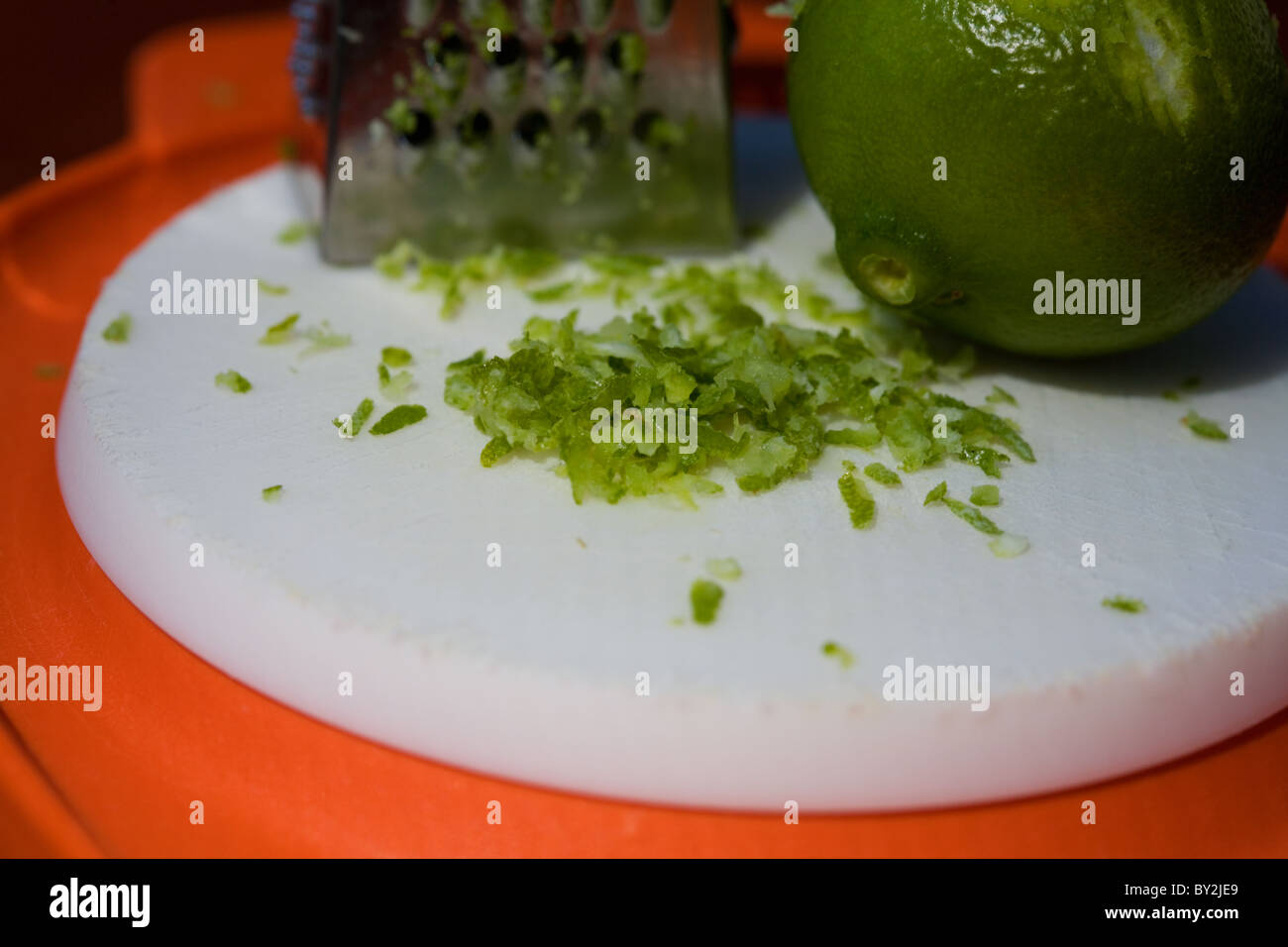 Grated keylime rind or zest with a grater - Stock Image