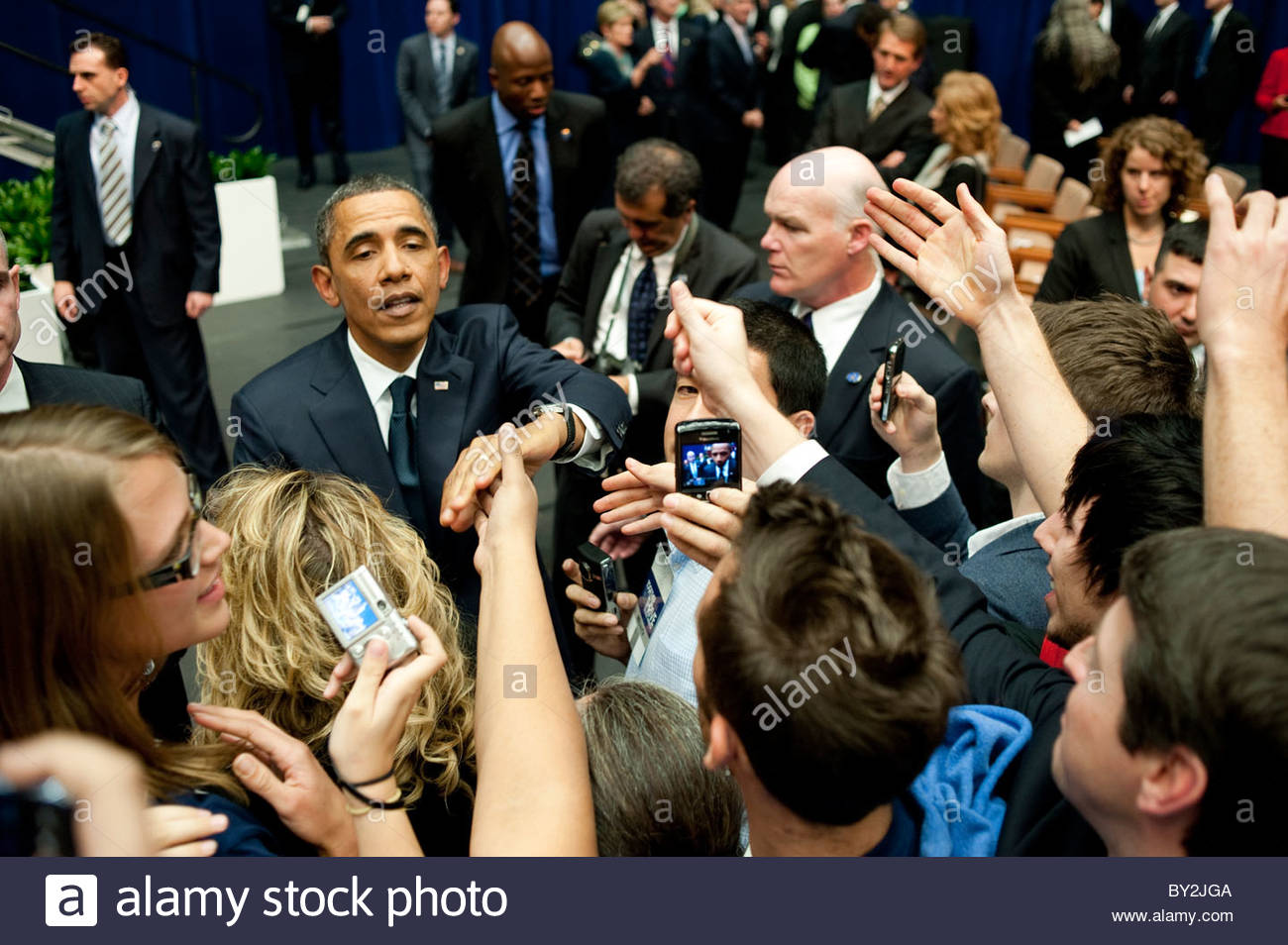 President Obama reaches out to shake hands at the end of the Memorial event in Tucson for Victims of the Safeway - Stock Image