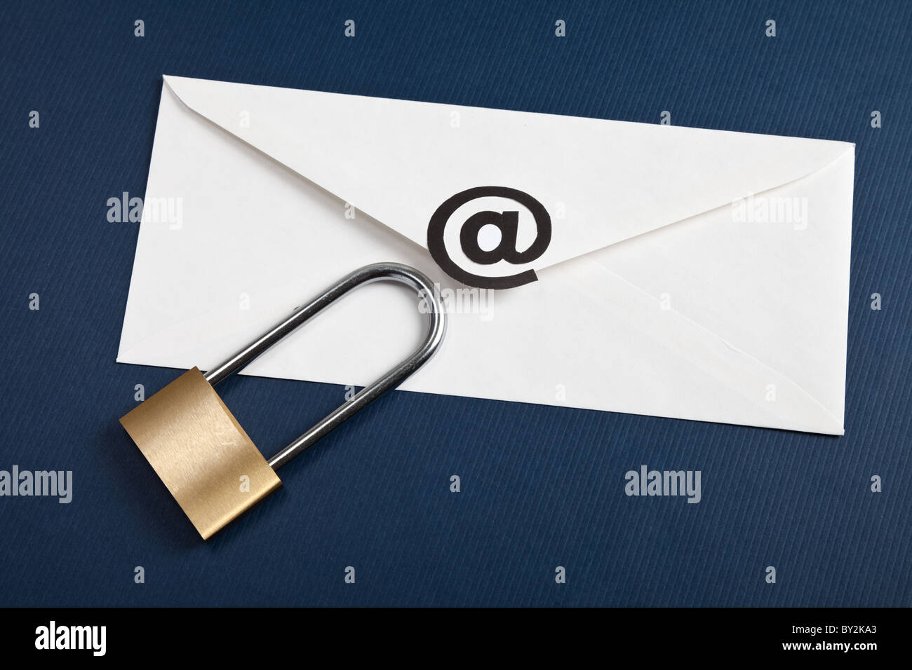Envelope with @ Symbol and lock, concept of E-Mail Security - Stock Image