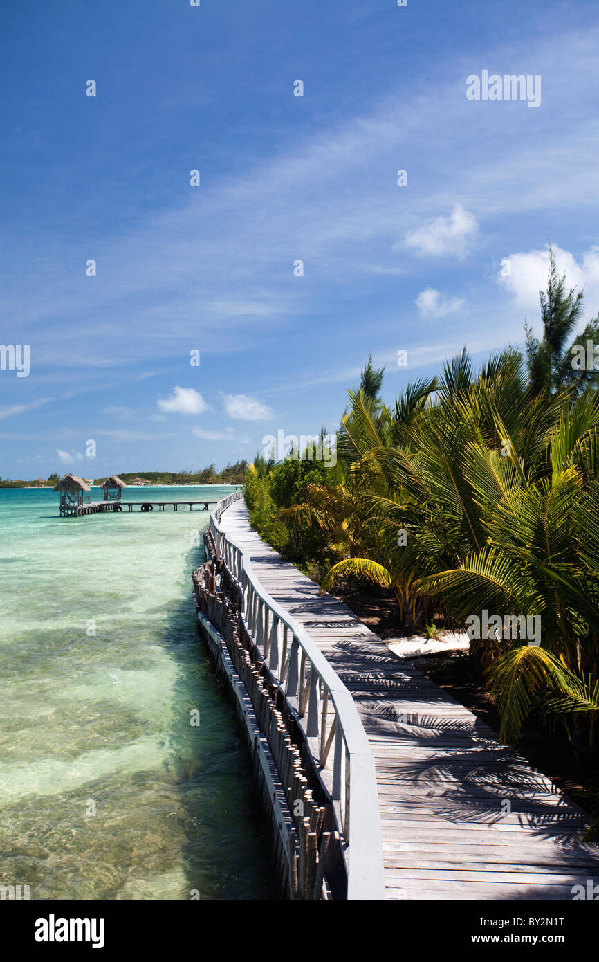 A boardwalk near the crystal clear waters of the Caribbean. - Stock Image