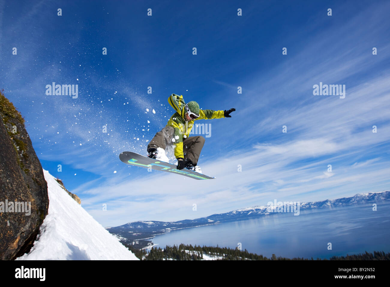 A snowboarder catches air in Lake Tahoe, California. - Stock Image