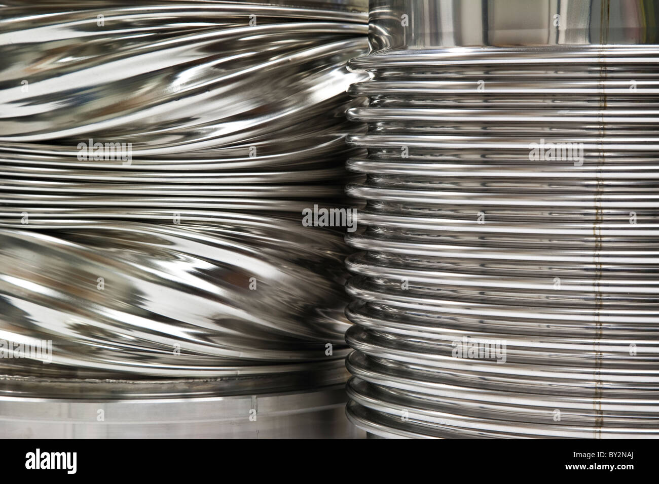 Comparison between a newly formed stainless steel bellows and one deformed in a test situation - Stock Image