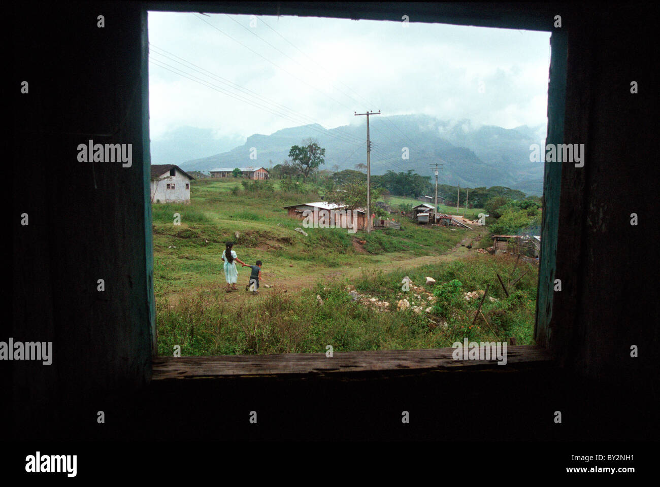 View from inside a window in a Zapatista community in the state of Chiapas, Mexico. - Stock Image
