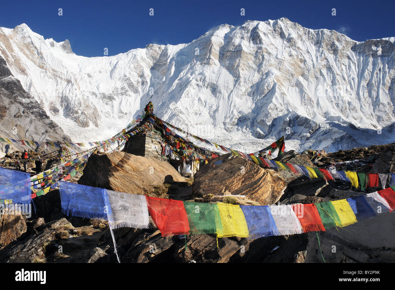 Prayer flags flying in front of the South Face of Annapurna - Stock Image